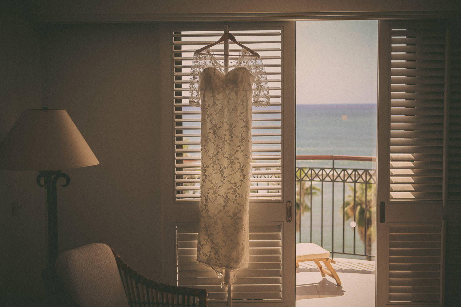 Kirsty Doylel wedding gown hanging in window at the Annabelle in Cyprus