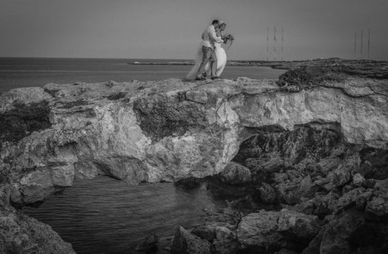 Bride and Groom on Love Bridge take from a Beautiful wedding photography from Capo Bay hotel and Cape Grecco in Protaras Cyprus