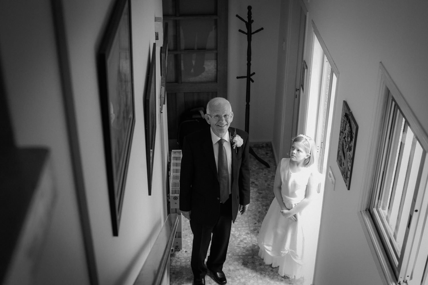 father of the bride waiting at the bottom of the stairs Greek Orthod wedding larnaca