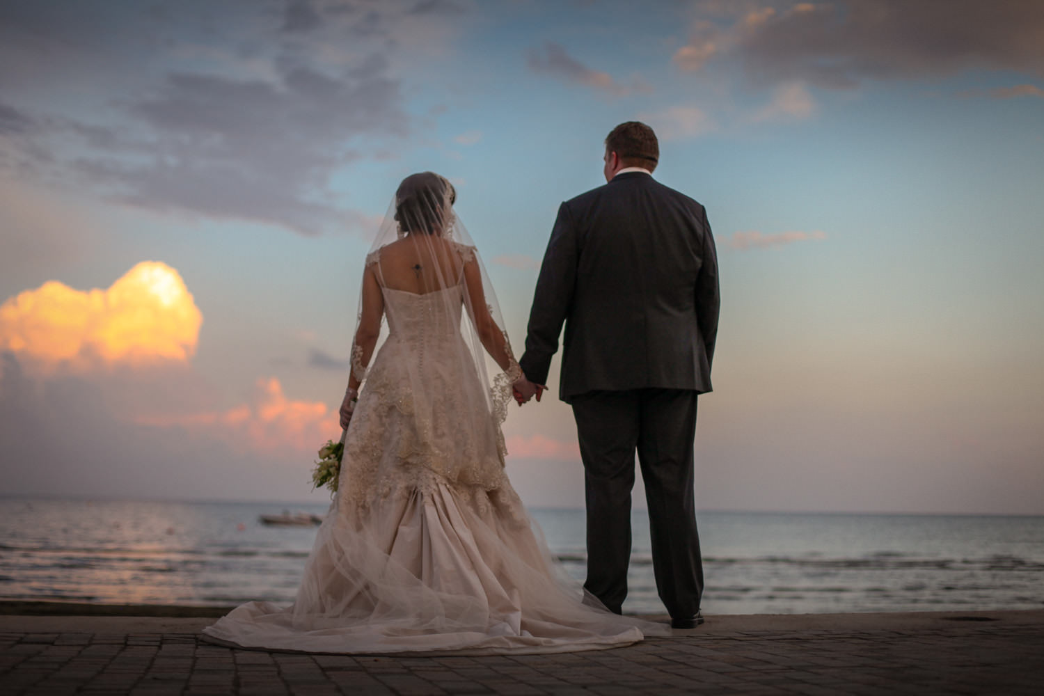 Beautiful photo of bride and groom looking at sunset in Larnaca Cyprus