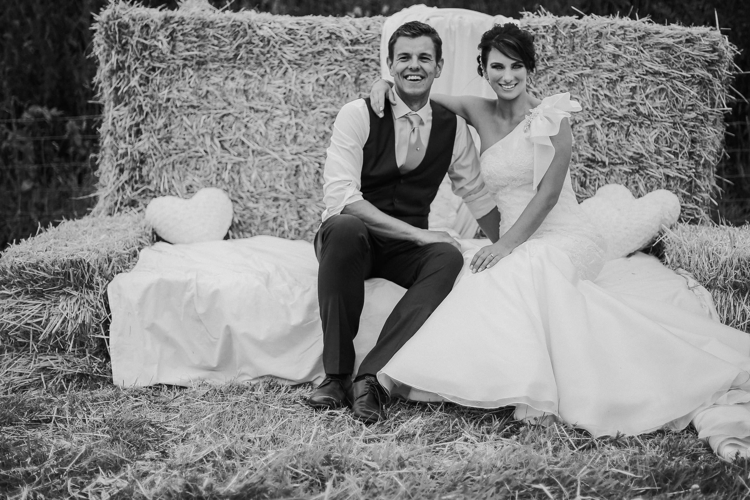 Marquee Wedding Lancashire Bride and Groom on bales of hay Maggie Sottero wedding dress