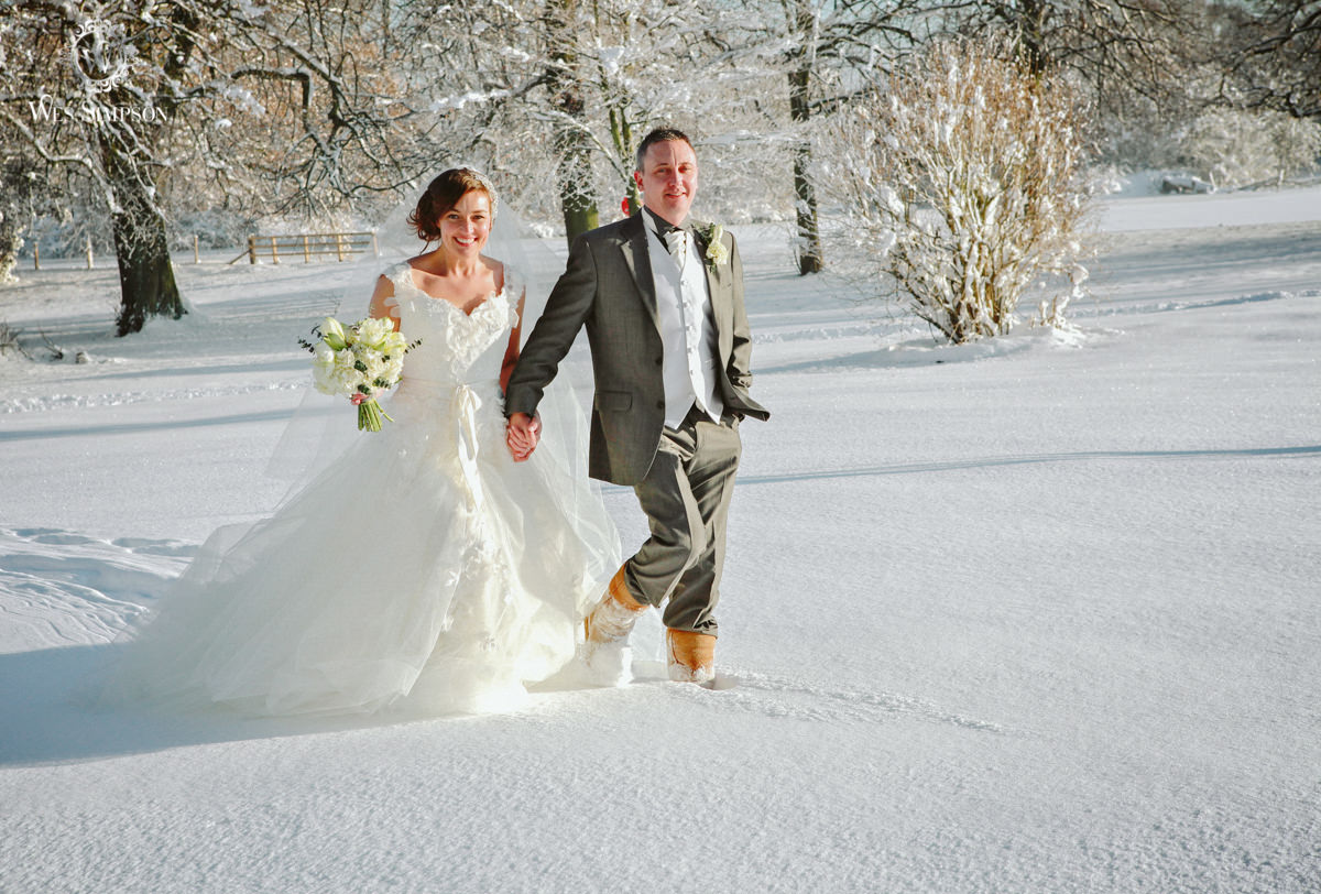 Bride and groom in snow, winter wedding southport photographer