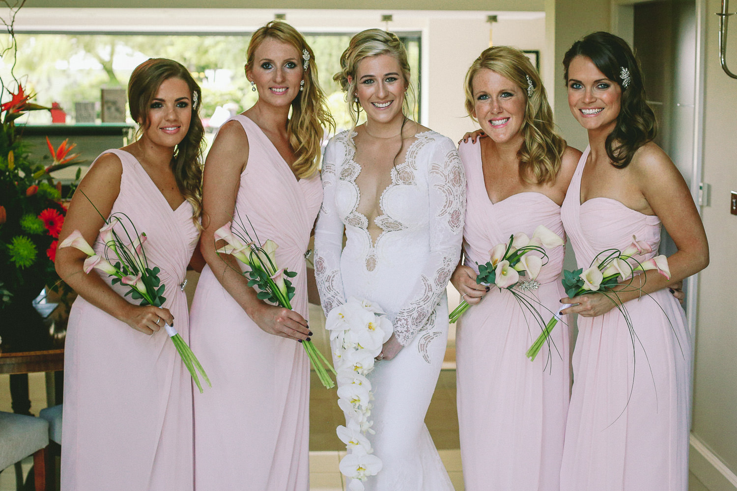 Bride and bridesmaids in Berta wedding dress Lancashire wedding area green