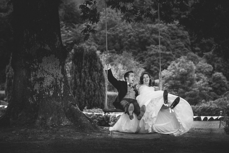 Bride and groom on a swing Broadoaks wedding venue