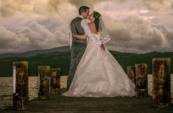 Broadoaks Country House wedding - Bride and groom on Lake Windermere jetty
