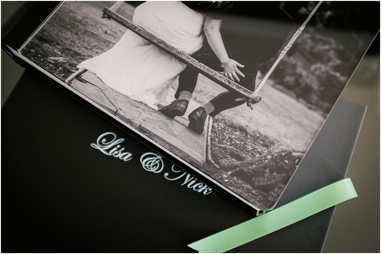 Cover of storybook wedding album photographed Broadoaks wedding venue Lake District