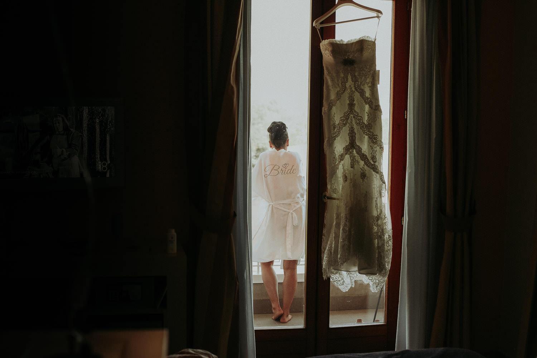 Bride enjoying view from balcony at bridal preparations with Pronovias wedding dress in Sorrento Amalfi Coast