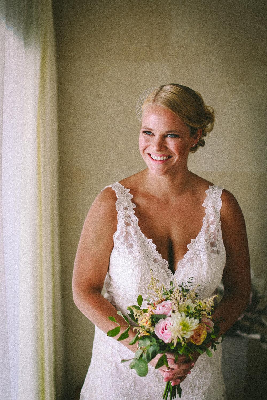 bride wearing Essence of Australia wedding dress getting ready for Lindos wedding