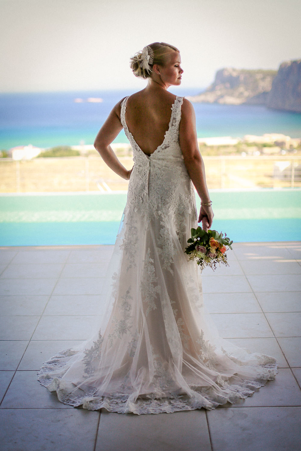 Lindos wedding photography, back of brides dress with view of ocean