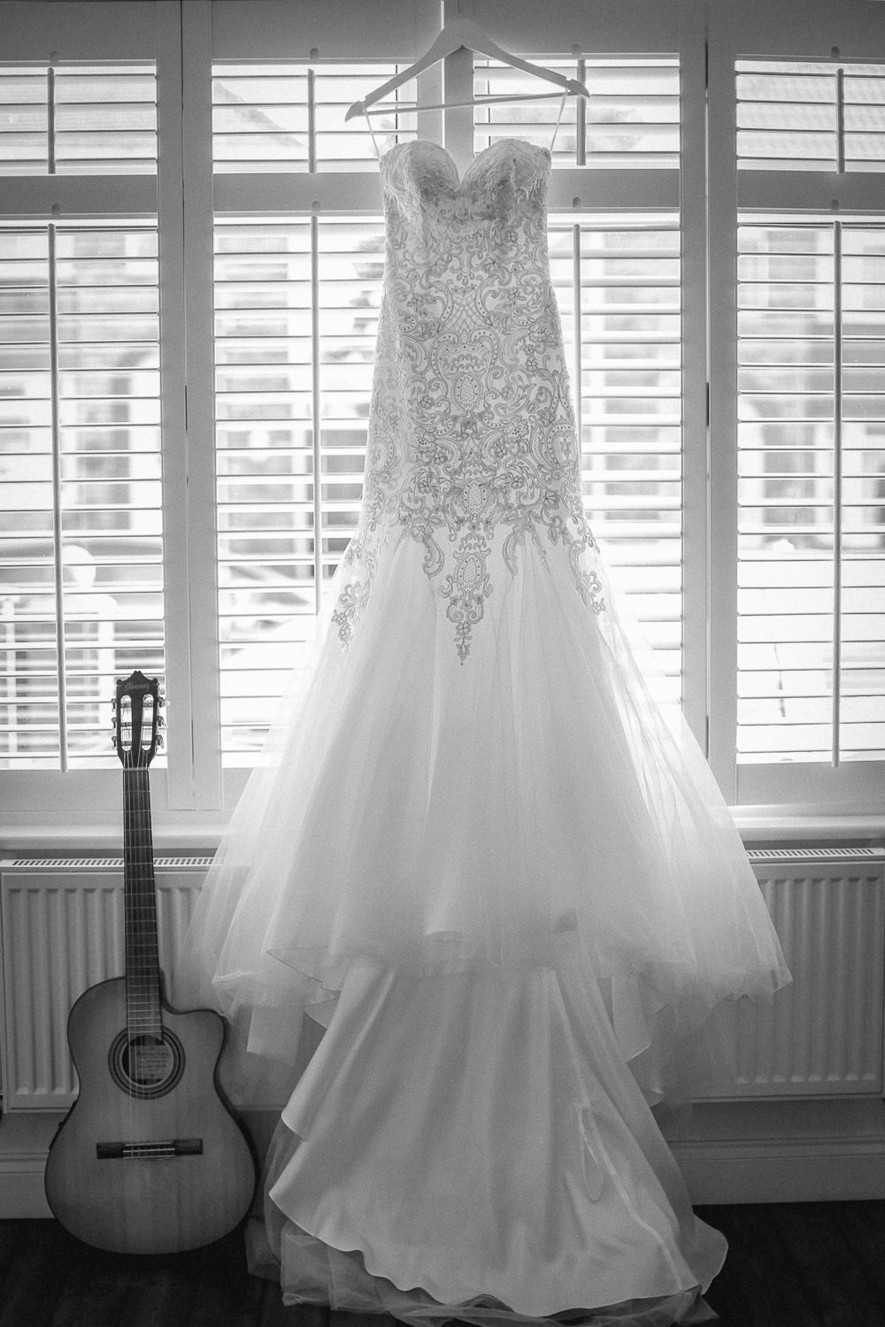 More Lee sweetheart fishtail Wedding dress and guitar on wedding morning