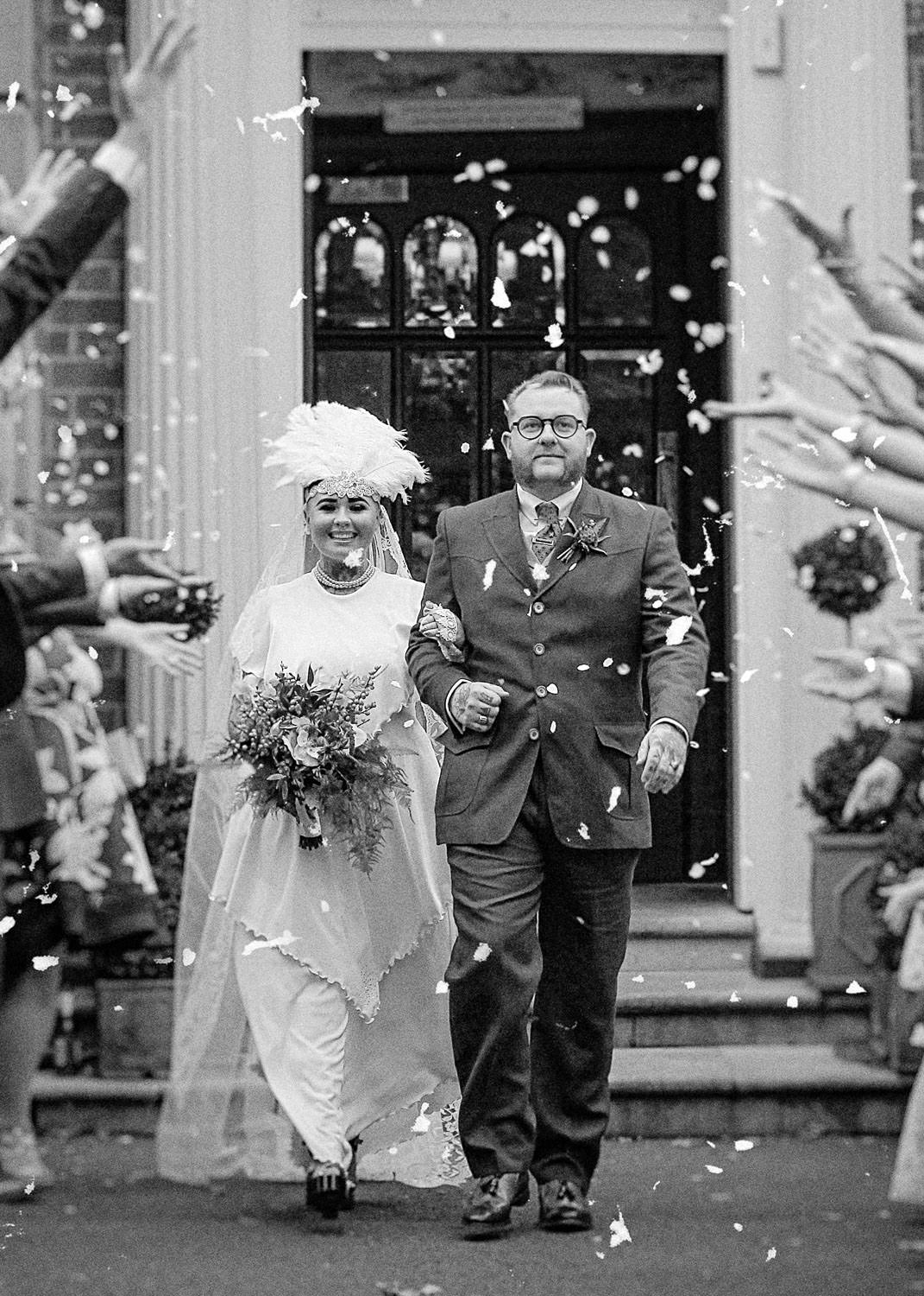 Vintage bride and groom confetti at Ashfield House. Wes photographs all the fun of your wedding