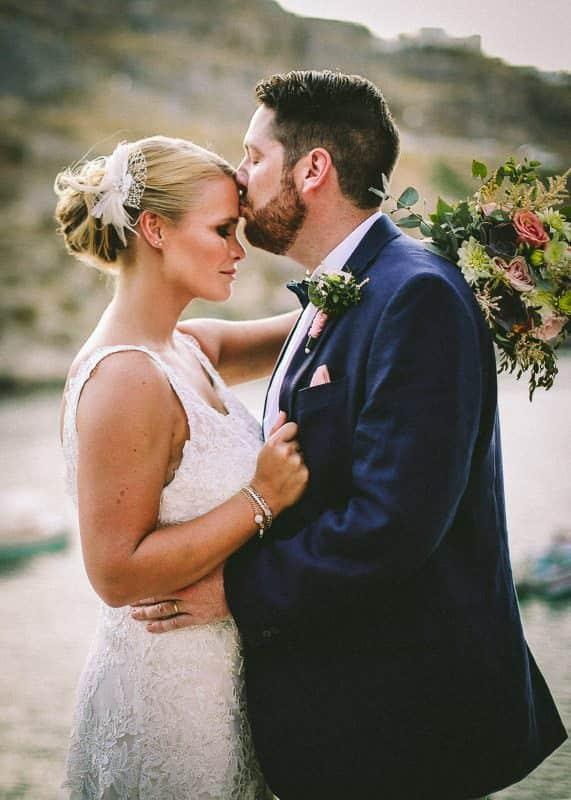 Destination weddings 3rd eye kiss. Bride and groom Lindos destination wedding