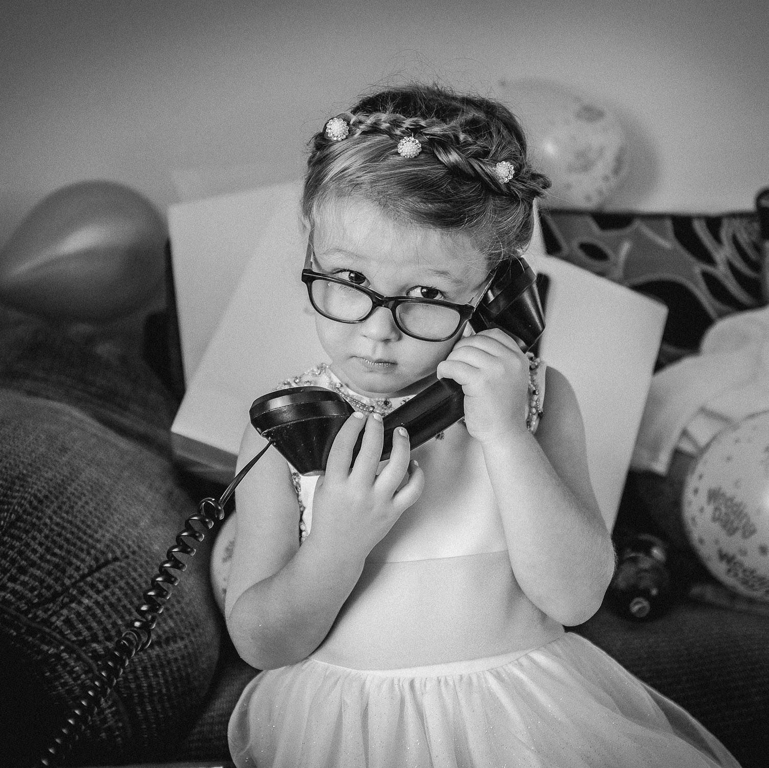 Little flower girl on old phone