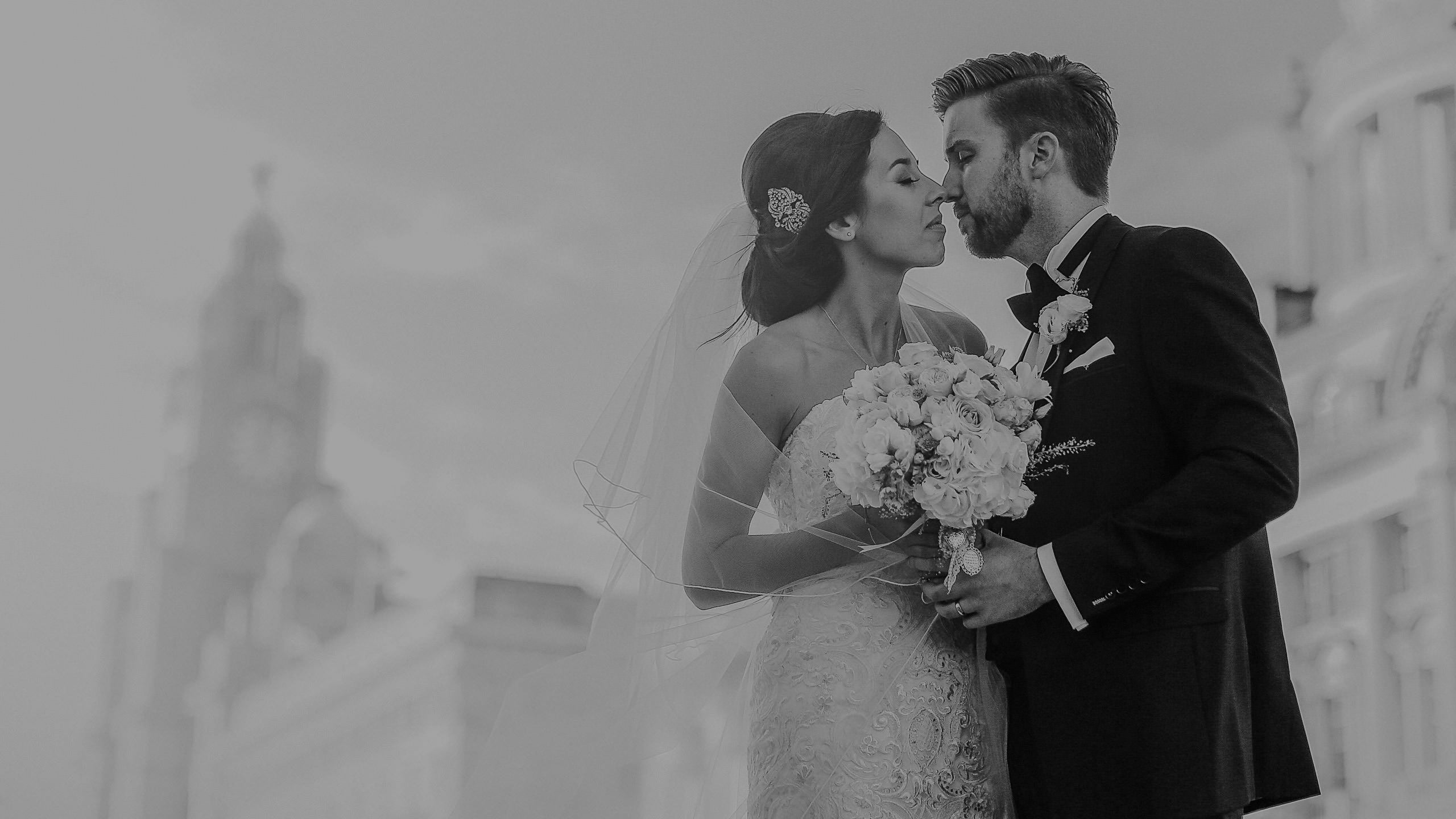 Modern bride and groom kissing Liverpool waterfront Liverbuilding