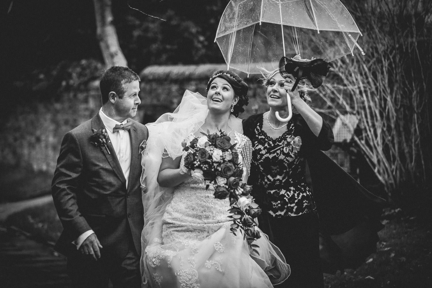 Bride arriving in the rain for Lancashire wedding Skelmersdale