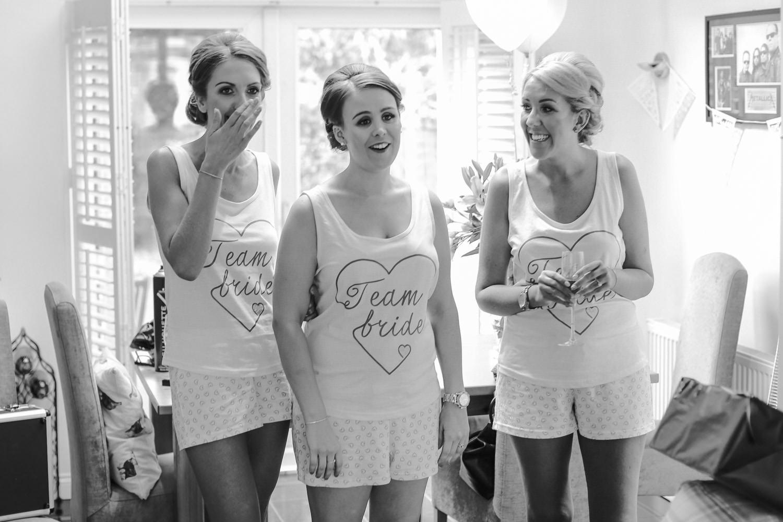 Bridesmaid reaction to bride in Mori Lee wedding gown