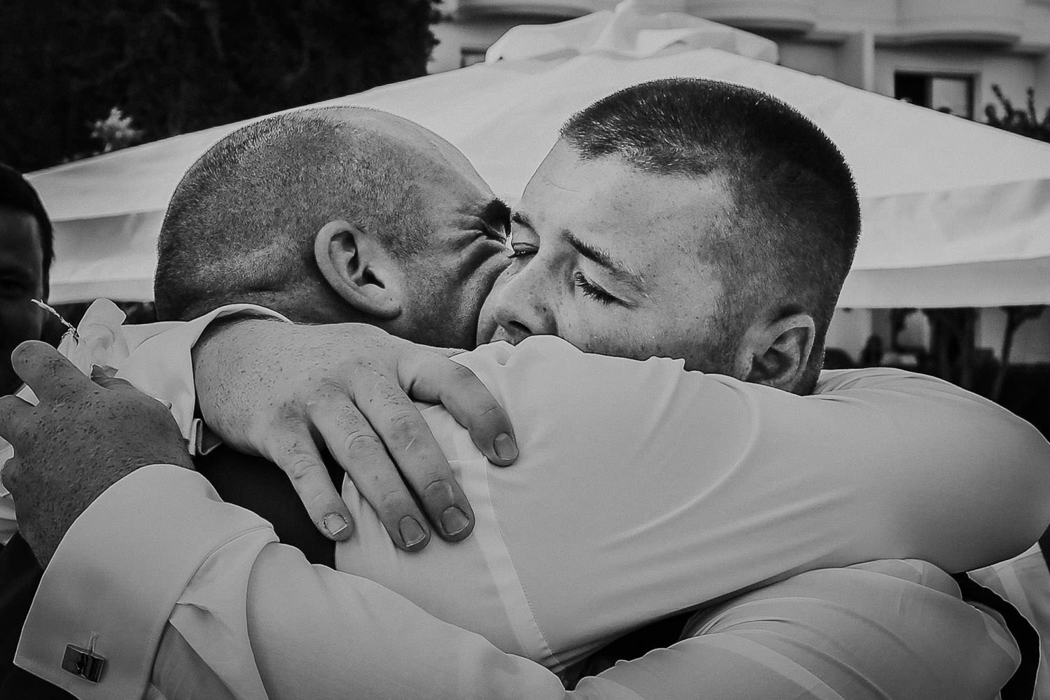 father son embrace and cry at wedding in Cyprus at Annabelle Hotel