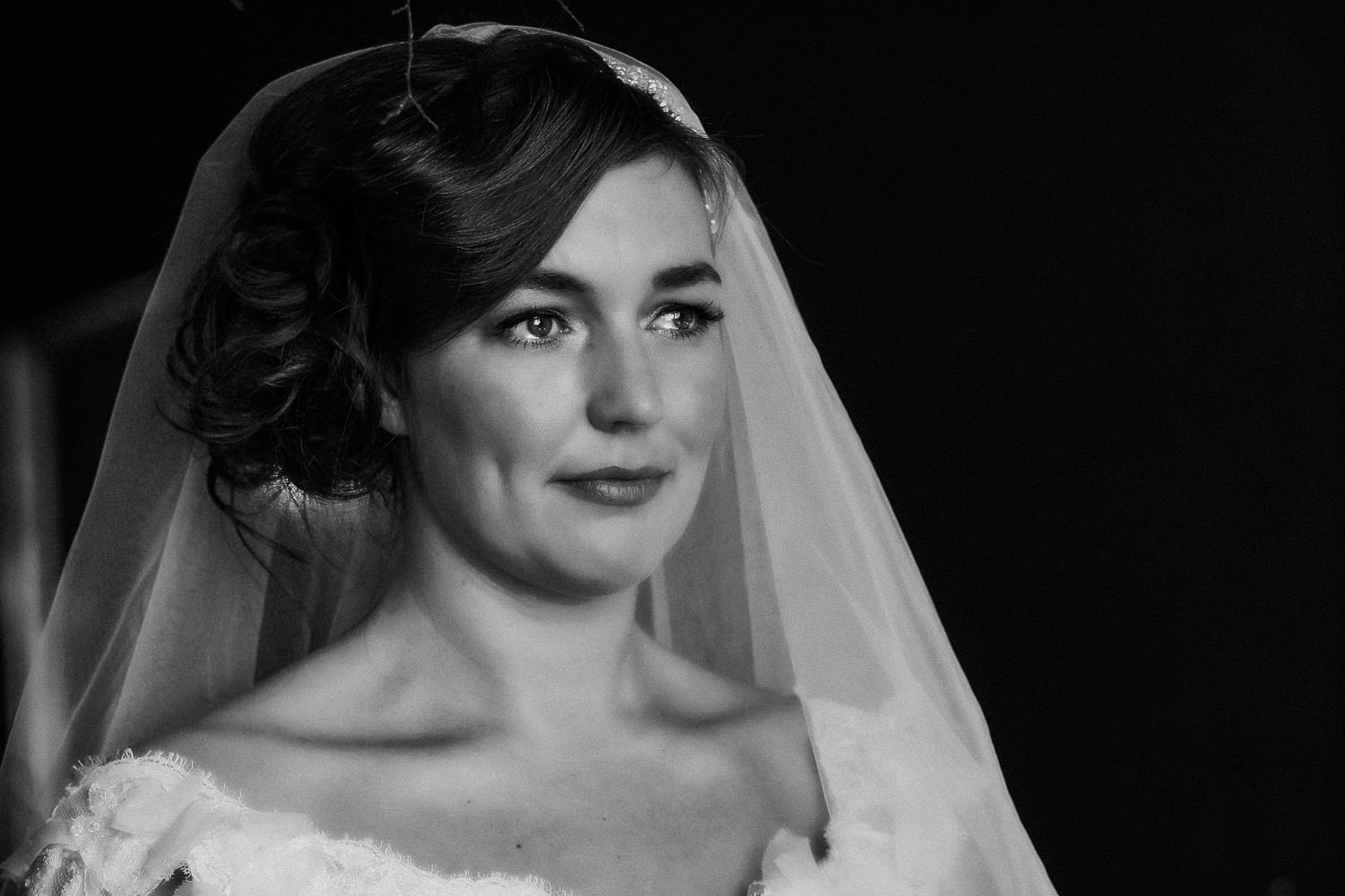 Bride holding back the tears on wedding day