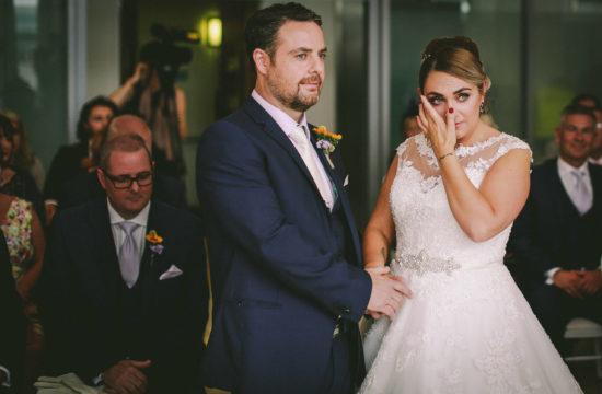 Liver Building wedding Bride wiping tears during wedding ceremony Royal Liver Building Liverpool