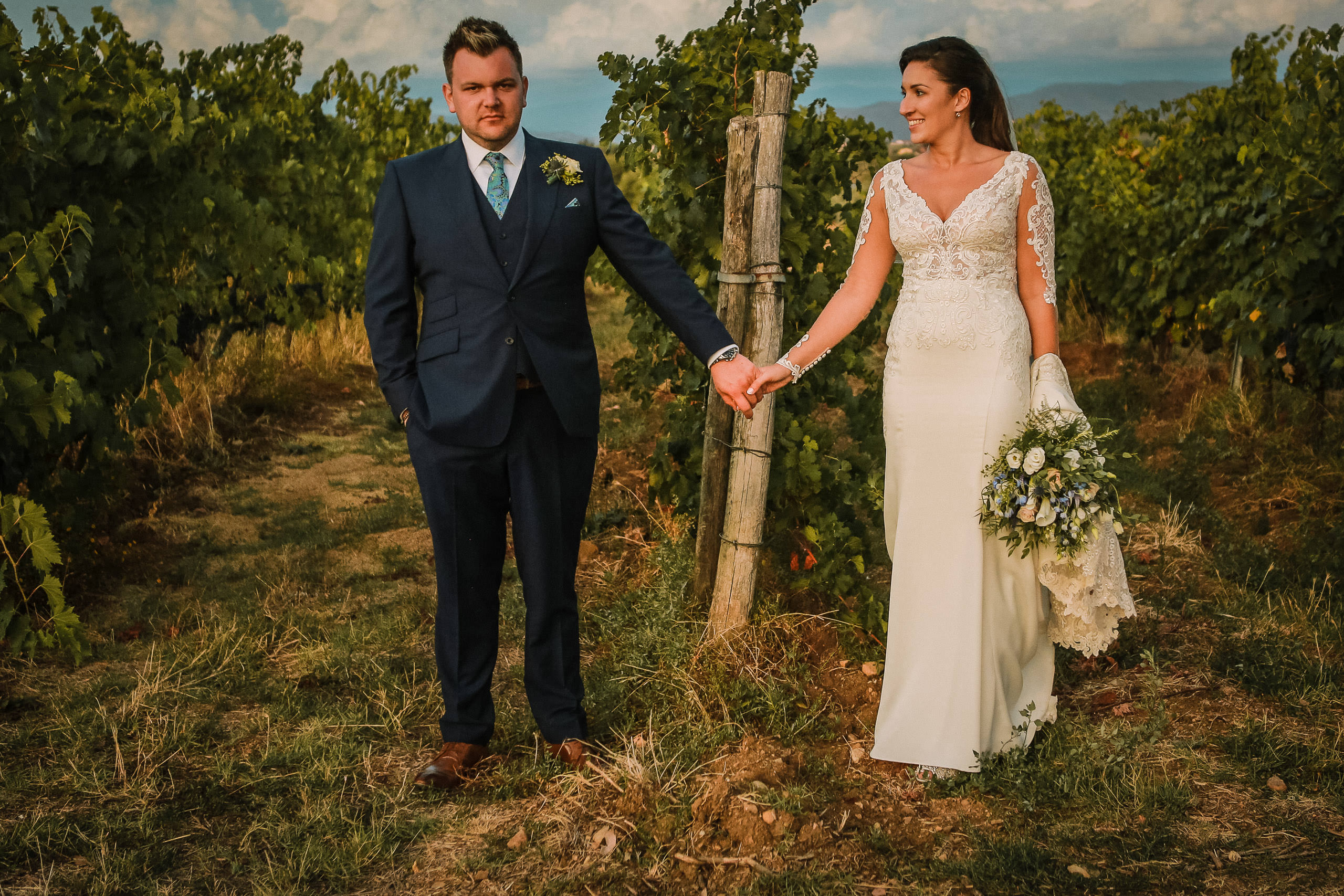 Tuscany wedding photography bride and groom in Tuscan vineyards