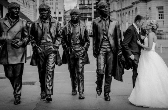 Hilton Liverpool wedding photography Bride and groom with The Beatles statue Liverpool Pier head