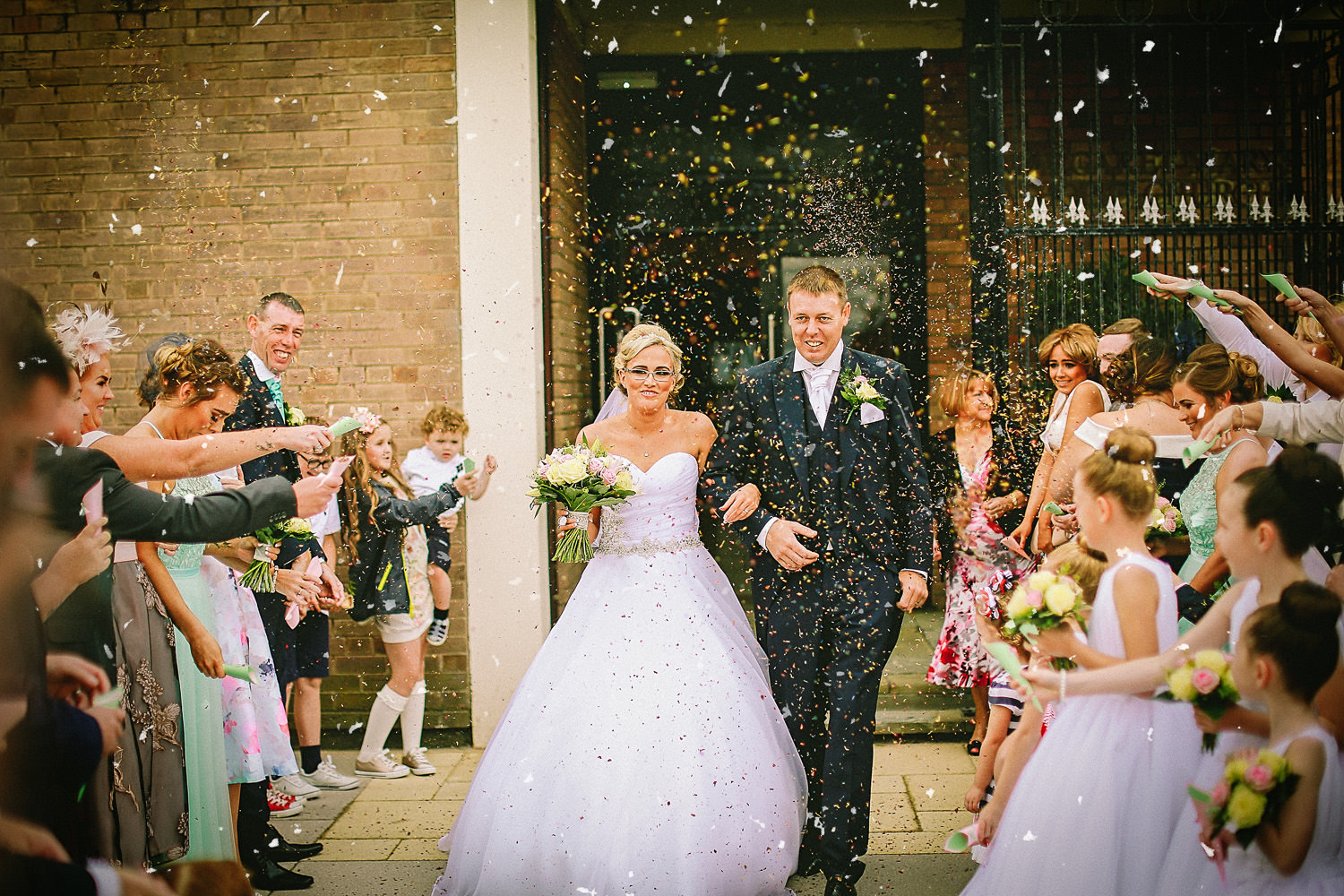St. Margaret Mary's in Liverpool brider and groom confetti picture