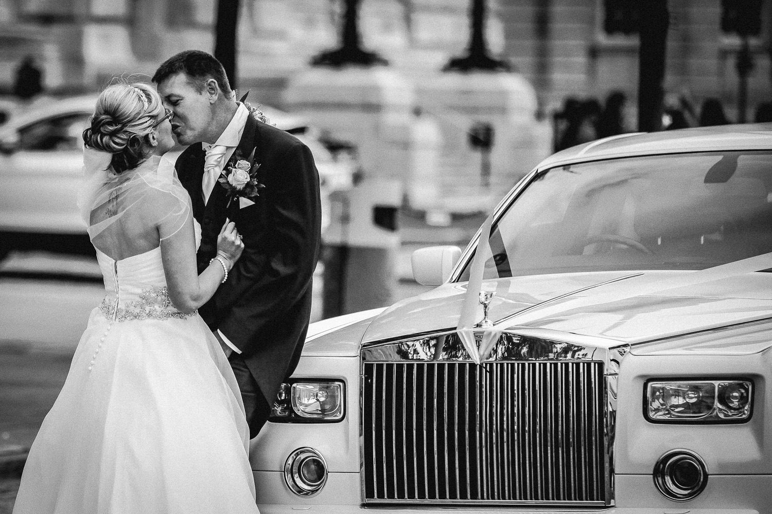 bride and groom with white Rolls Ryce during Liverpool Hilton Wedding