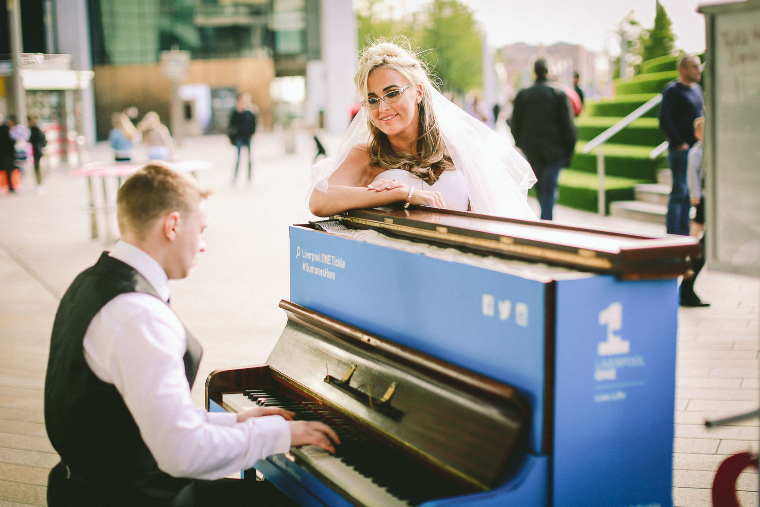 Bride with Liverpool one busker Liverpool wedding photography