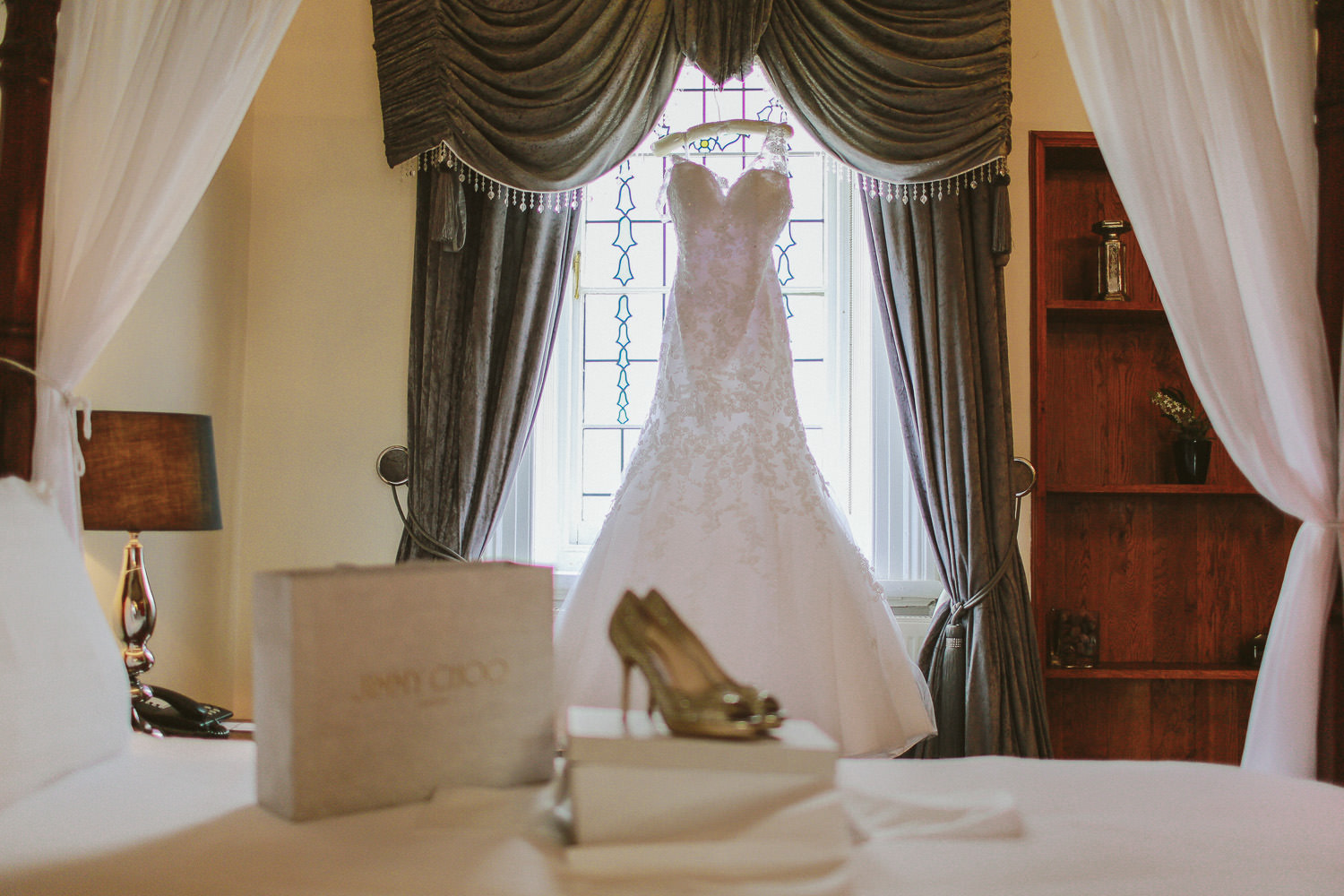 Jimmy Choo Shoes and Morille wedding dress hanging up at West Tower Aughton bridal suite