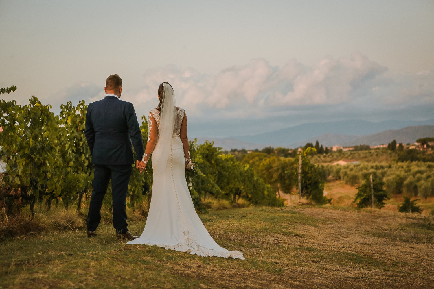 Bride and groom in Tuscany vine yard