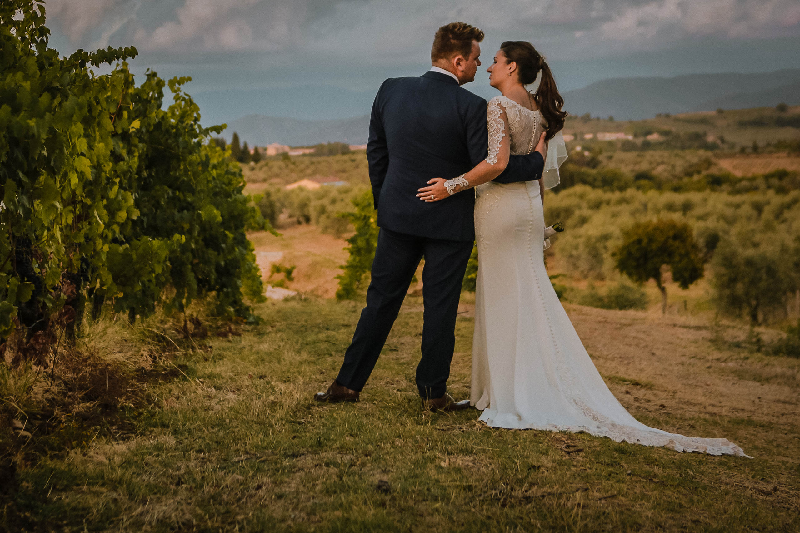Tuscany wedding photography. Bride and groom in vineyards