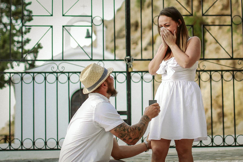 engagementphoto shoot man proposing on one knee St Pauls bay lindos wedding photography