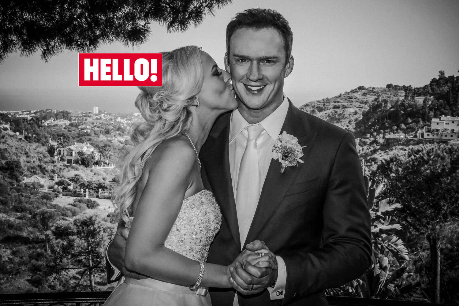 Celebrity wedding photographer. Hello magazine front cover black and white photo Bride kissing Russell Watson on cheek