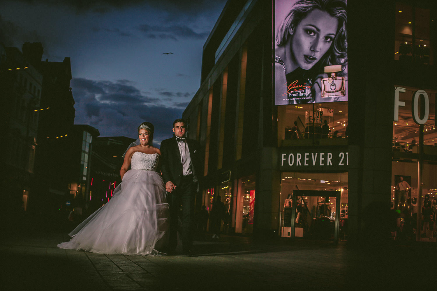 Liverpool wedding photographer. Bride and groom walking forever 21 in Liverpool