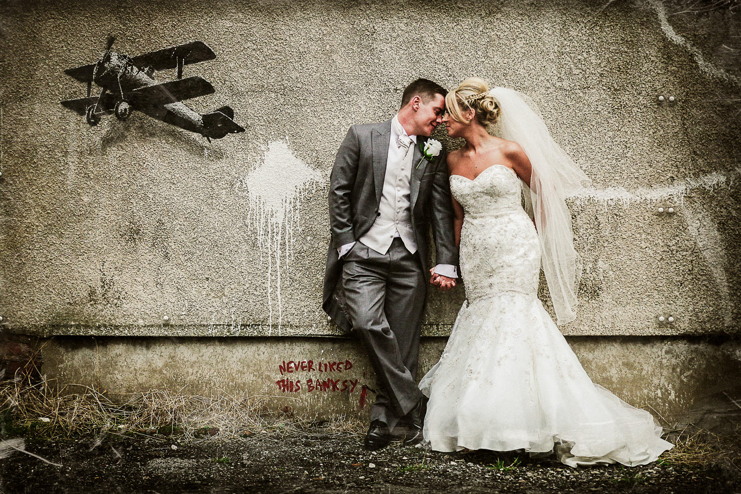 Liverpool wedding photographer Wes Simpson picture of Bride and Groom Banksy Love Plane