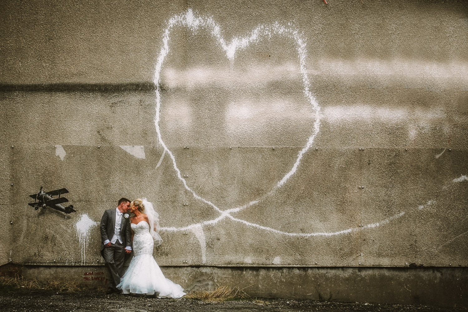 Liverpool wedding photographer Wes Simpson photo of Bride and Groom Banksy Love Plane