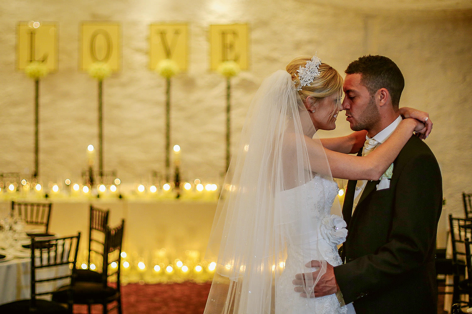 Lancashire wedding photographers. Bride and groom with love sign Stanley House wedding venue Lancashire