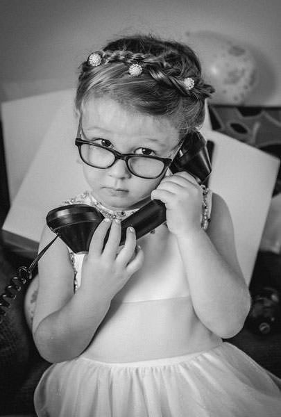 Contact Wes Simpson Little girl with old phone