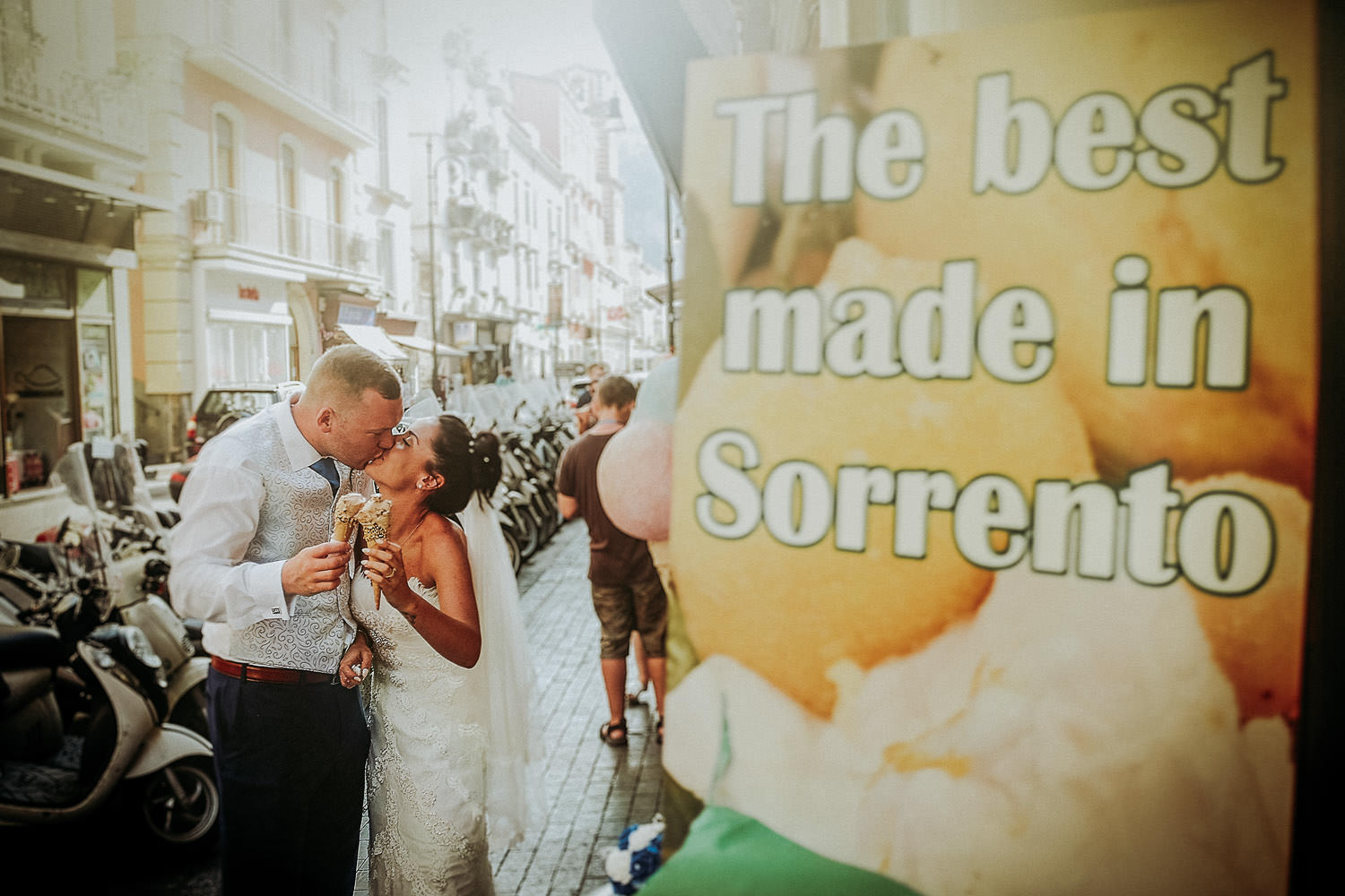 Destination wedding photographer photo of Bride and groom kissing with ice cream in Sorrento