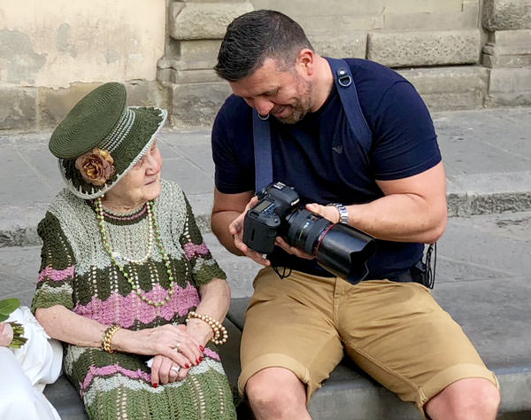 photographer showing old lady camera