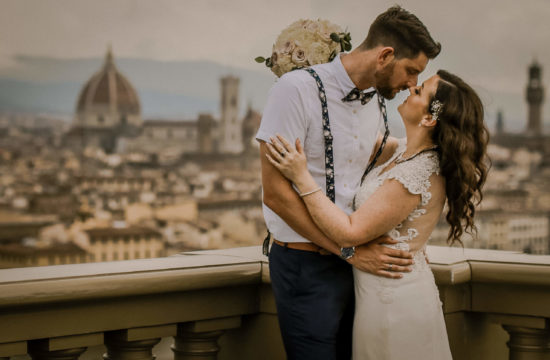Wedding couple kissing with view of Florence Italy