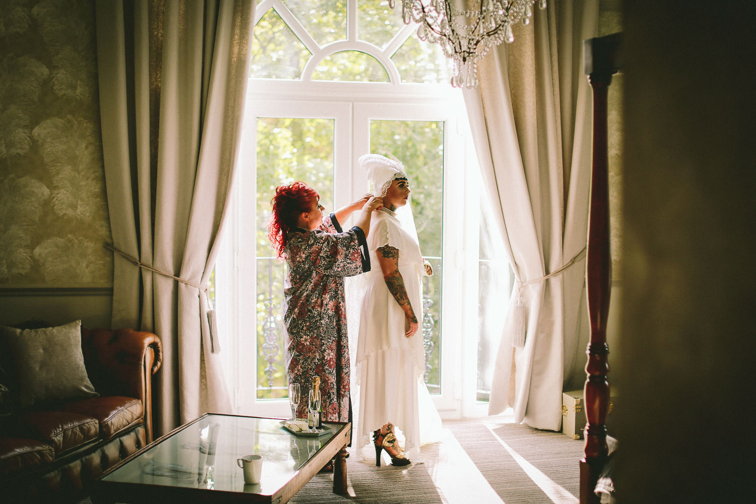 Bride and mother getting ready during vintage wedding at Ashfield House Standish