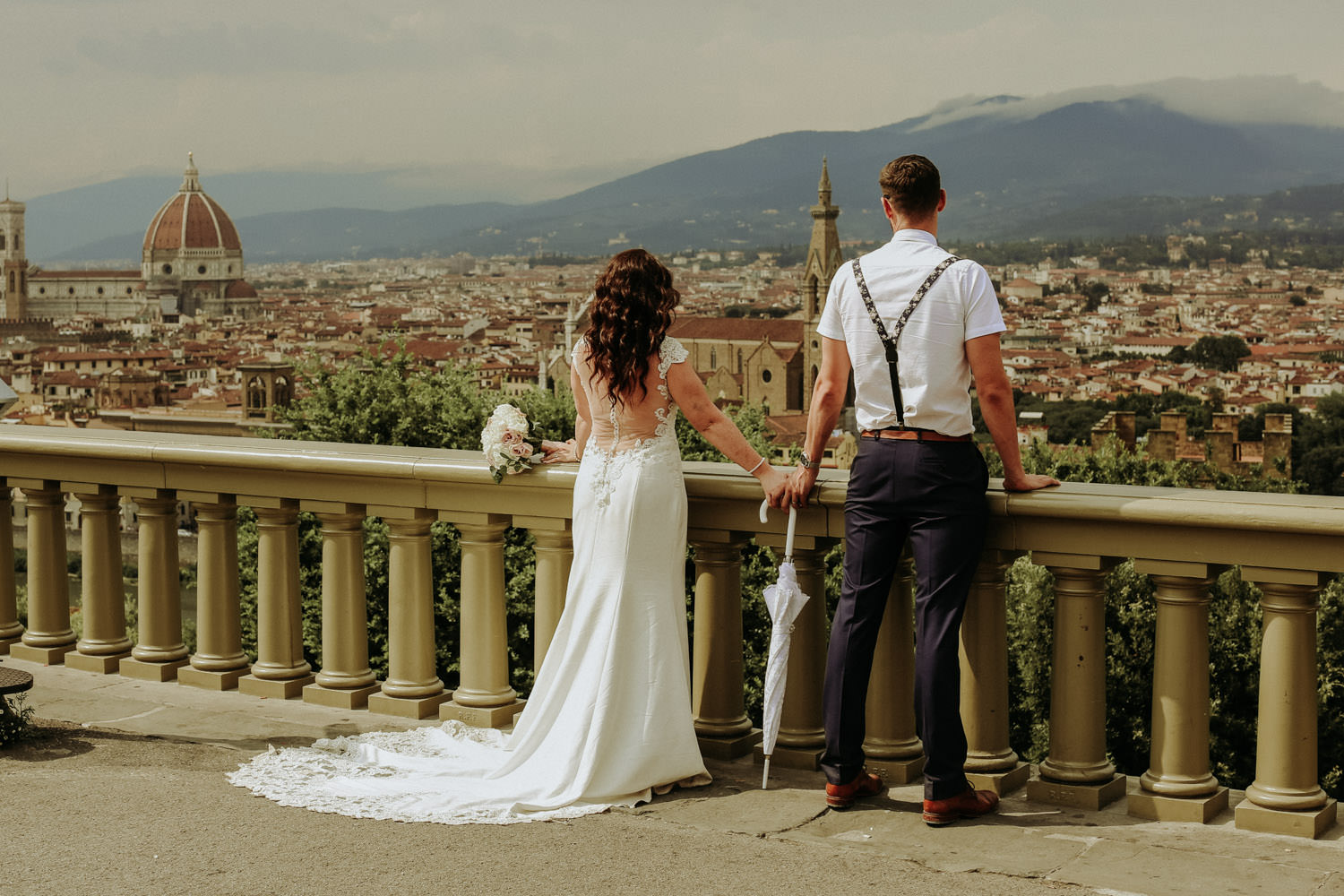 Florence destination wedding photographer photo of wedding couple looking at view of Florence