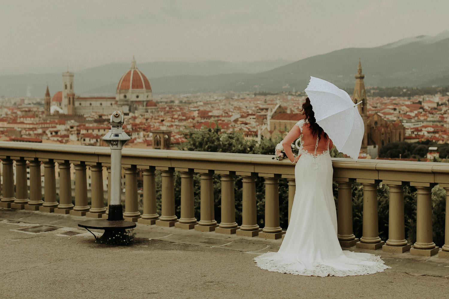 Bride with Umbrella looking at view of Florence and cathedral