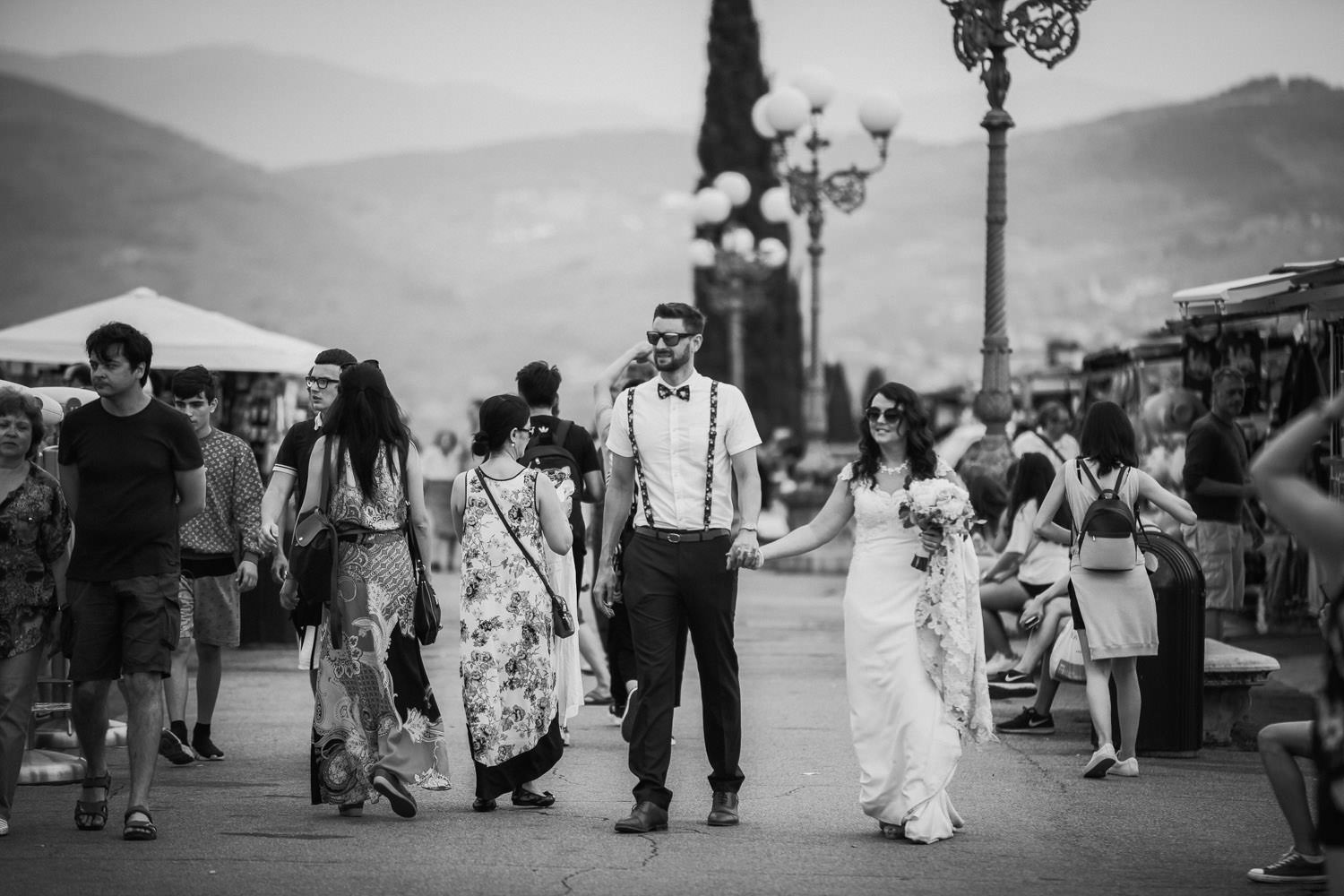 Black and white wedding picture bride and groom walking in Florence