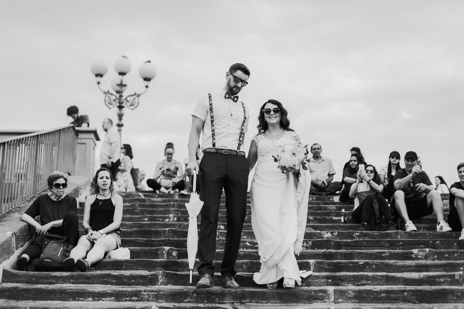 Black and white photo of wedding couple walking down steps in Florence