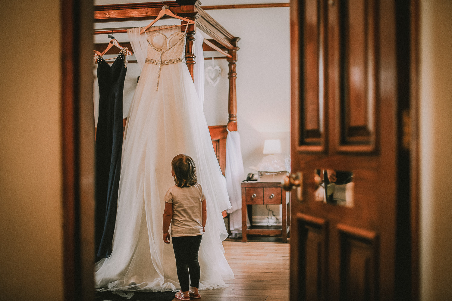 How much is a wedding photographer. Little girl look at wedding dress