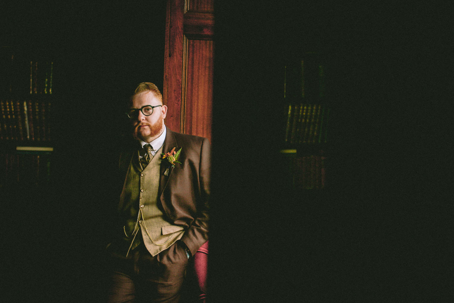 Portraits of vintage groom with pocket watch at Ashfield House Standish