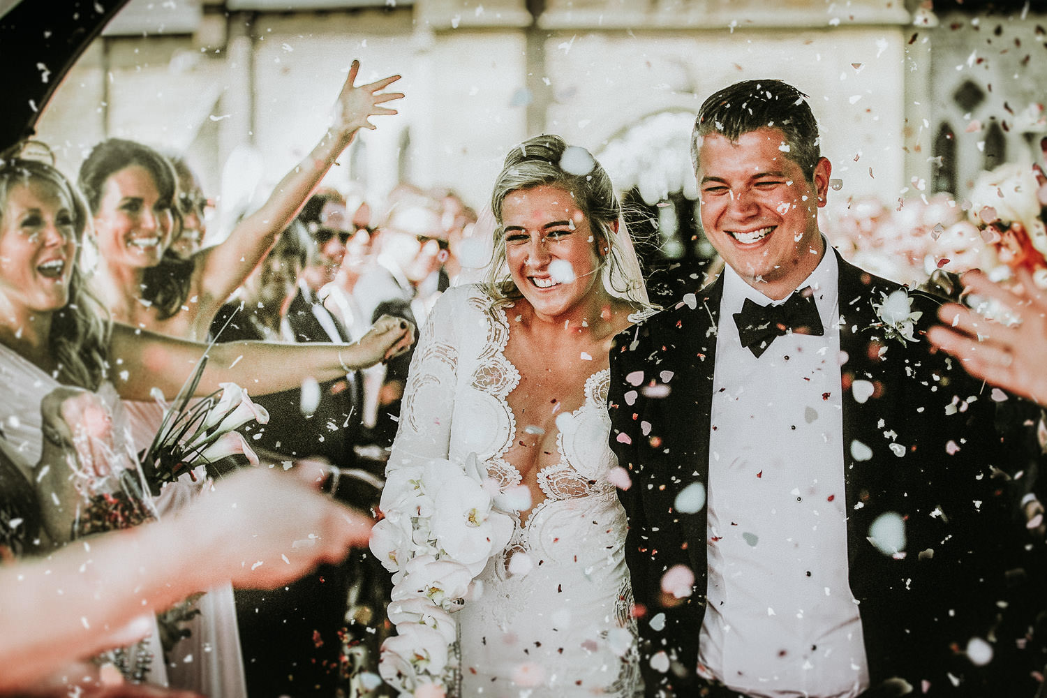 cost pf wedding photography bride and groom showered in confetti on wedding day