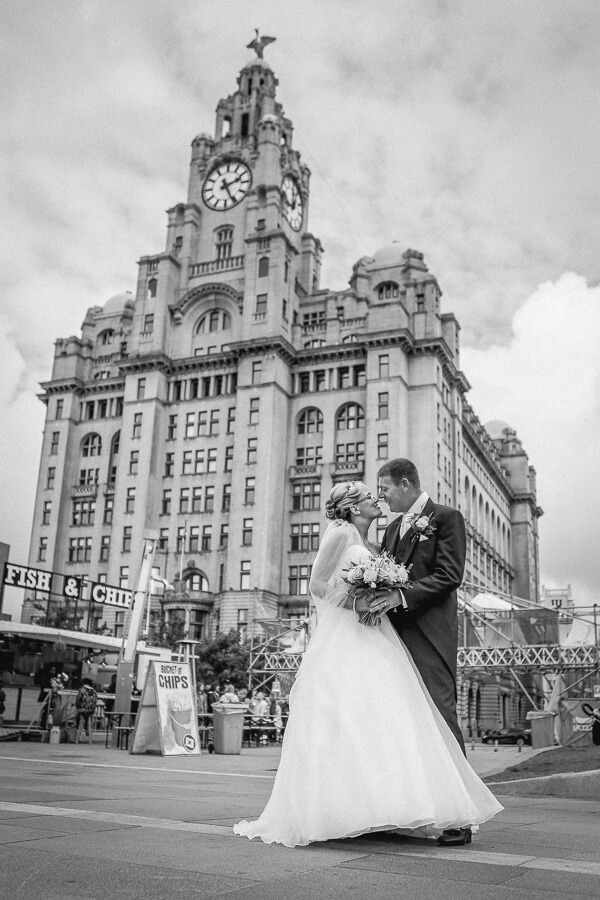 wedding photographer Liverpool black and white wedding photo Liverpool Building and bride and groom